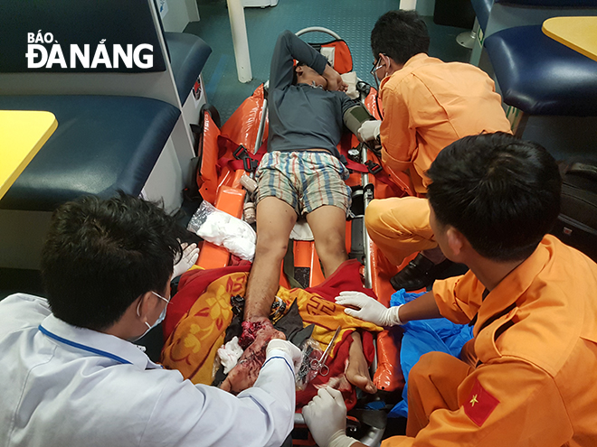 Doctors giving initial first aid to the injured fisherman