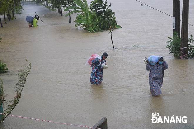 A road leading to Tay An Village, Hoa Chau Commune, being turned into a river, following torrential rain