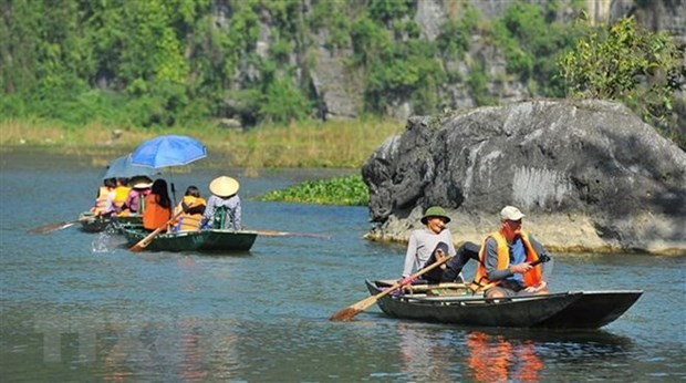 Foreign visitors at Tam Coc-Bich Dong tourism site (Photo: VNA)