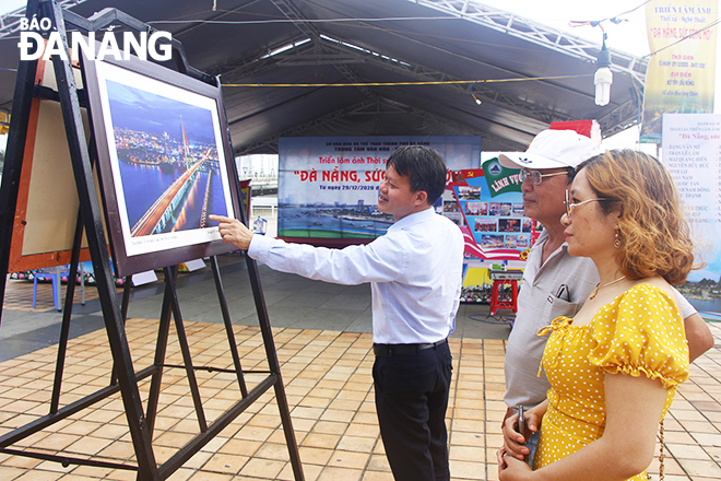 The ongoing 'Da Nang, New Vitality' photo exhibition at the western side of the Rong (Dragon) Bridge, opposite the Museum of Cham Sculpture, attract a great deal of attention from locals and visitors
